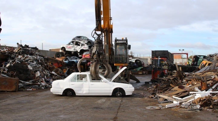 Scrapping car with crane