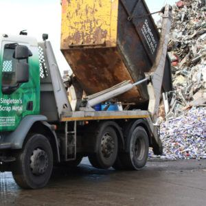 Tipping scrap metal out of skip