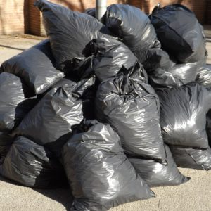 Pile of fly-tipped black rubbish bags